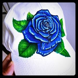 An original blue rose permanently drawn on cap